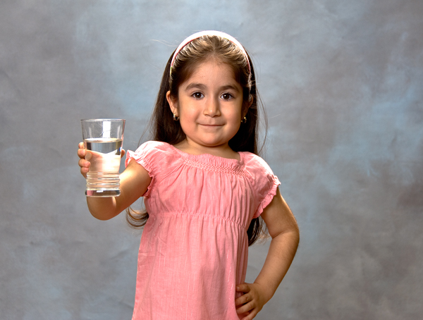 Young Girl Holding a Glass of Water